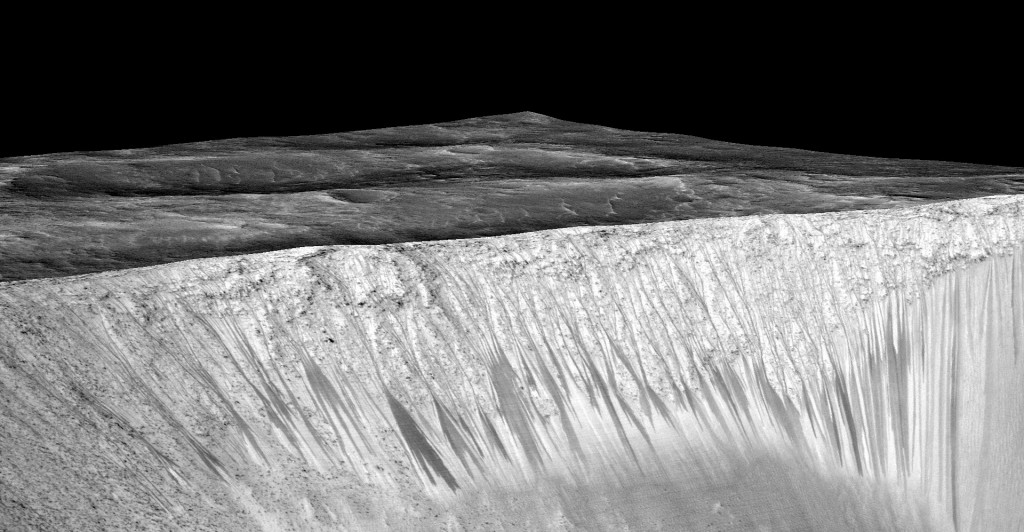 These RSL on the slopes of the Garni crater are several hundred metres long. (Image credit: Mars Reconnaissance orbiter/University of Arizona/JPL/NASA).
